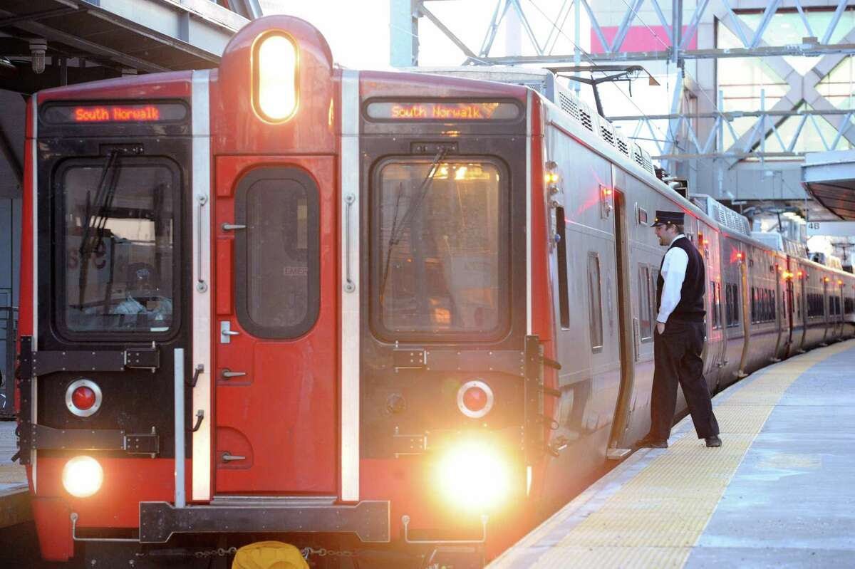 A conductor inspects the platform before a Metro-North train leaves the Stamford Train Station.