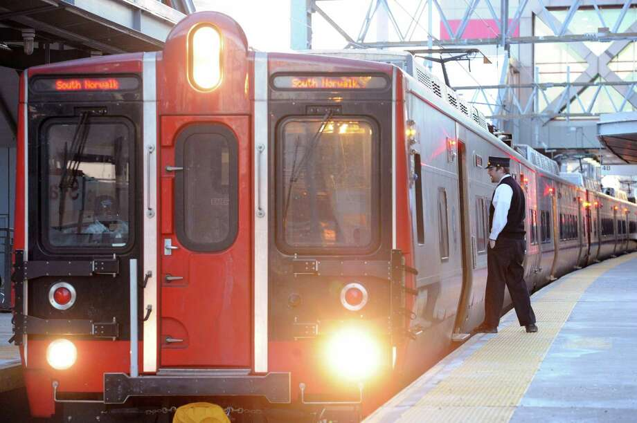 A conductor inspects the platform before a Metro-North train leaves the Stamford Train Station. Photo: Bob Luckey / Bob Luckey / Greenwich Time