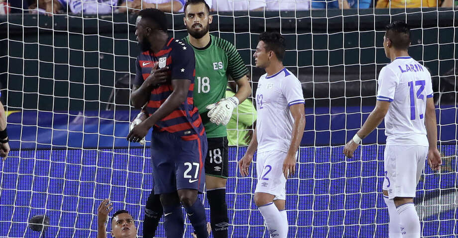 El Salvador's Derby Carrillo (18) holds Unites States' Jozy Altidore (27) as he reacts to an incident with El Salvador's Henry Romero, lying on the ground, during a CONCACAF Gold Cup quarterfinal soccer match in Philadelphia, Wednesday, July 19, 2017. Romero appeared to first bite Altidore on the back of a shoulder and then pull the American forward's nipple. Canadian referee Drew Fischer, a Major League Soccer regular, did not penalize the incident. (AP Photo/Matt Rourke) Photo: Matt Rourke/Associated Press