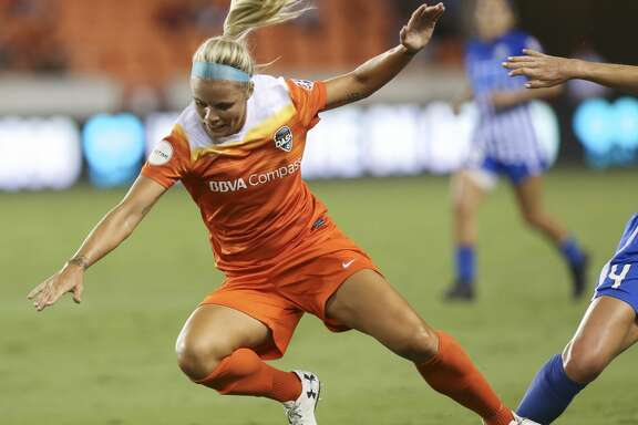 Houston Dash forward Rachel Daly (3) falls onto the ground while battling with Boston Breakers defender Megan Oyster (4) during the first half of the game at BBVA Compass Stadium Saturday, July 22, 2017, in Houston. ( Yi-Chin Lee / Houston Chronicle )