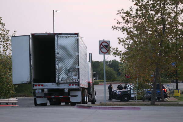 Law enforcement is at the scene where people were discovered inside a tractor trailer in a Walmart parking lot at IH35 South and Palo Alto Road, Sunday, July 23, 2017. Reports say that 8 were dead be several were in critical condition.