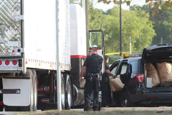 Law enforcement is at the scene where people were discovered inside a tractor trailer in a Walmart parking lot at IH35 South and Palo Alto Road, Sunday, July 23, 2017. Reports say that 8 were dead including two children and several were transported to area hospitals. Seventeen were with life threatening injuries.