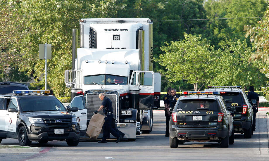Law enforcement at the scene, where people were discovered inside a tractor trailer in a Walmart parking lot at IH35 South and Palo Alto Road, Sunday, July 23, 2017. Reports say that 8 were dead and several were in critical condition. Photo: Edward A. Ornelas, San Antonio Express-News / © 2017 San Antonio Express-News