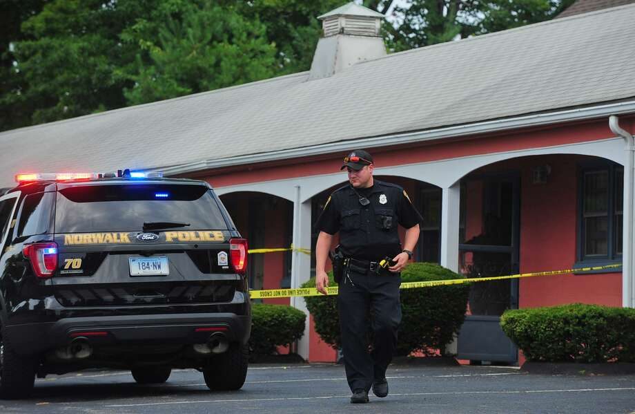 Norwalk police respond to a reported drug overdose Saturday, July 22, 2017, at the Garden Park Motel on Westport Ave. in Norwalk, Conn. Photo: Erik Trautmann / Hearst Connecticut Media / Norwalk Hour