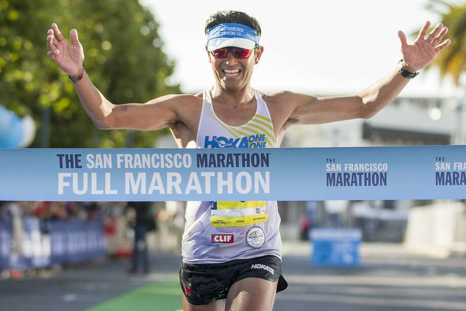 Jorge Maravilla finishes first place in the San Francisco Marathon on Sunday, July 23, 2017, in San Francisco, Calif. Maravilla finished the full marathon with an unofficial time of 2:28:22 and an average of 5:40 minutes per mile. Photo: Santiago Mejia, The Chronicle