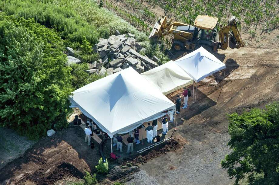 Investigators gather under tents as they search a property on July 12, 2017 in Solebury, Pa., for four missing young Pennsylvania men feared to be the victims of foul play. Photo: Clem Murray — The Philadelphia Inquirer Via AP   / Philadelphia Media Network
