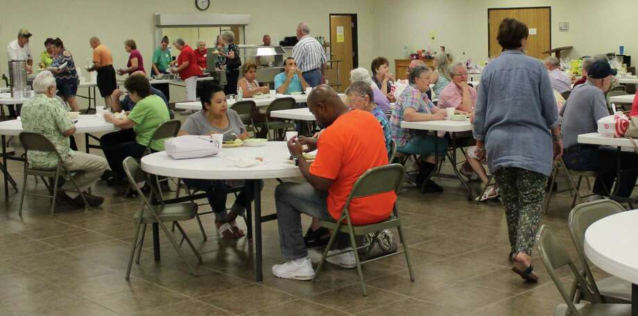 Visitors gather at the Cleveland Senior Center for its fundraiser on July 21. The proceeds from the fundraiser go to benefit the Cleveland Senior Center's Meals on Wheels program. Photo: Jacob McAdams