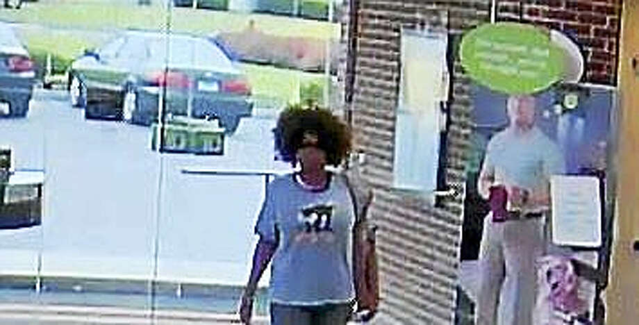 Police are looking for a female suspect in connection with a bank robbery Tuesday in Orange. Photo: Courtesy Of Orange Police