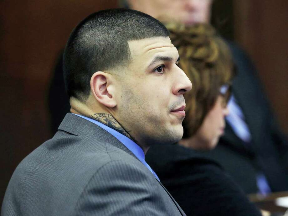 In this April 11, 2017 photo, defendant Aaron Hernandez listens as Judge Jeffrey Locke addresses the jury's question during his double murder trial at Suffolk Superior Court in Boston. A wrongful death lawsuit filed against the estate of former NFL star Aaron Hernandez is headed back to court. A status hearing is scheduled for Tuesday, July 11, 2017 in Suffolk County Superior Court. Photo: AP Photo — Elise Amendola, Pool, File   / Copyright 2017 The Associated Press. All rights reserved.