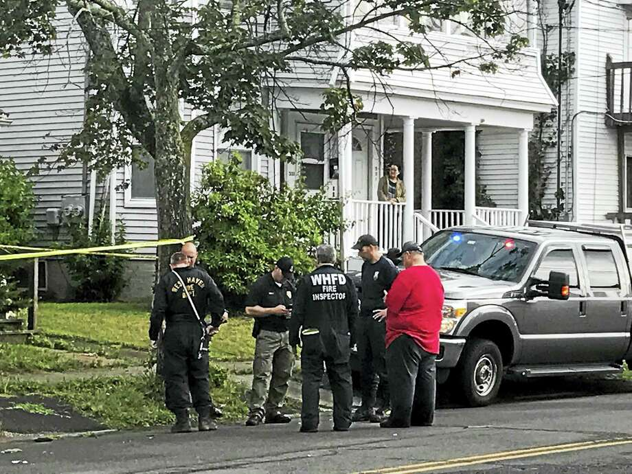 Authorities investigate a house fire in West Haven Tuesday. Photo: Jessica Lerner / Hearst Connecticut Media