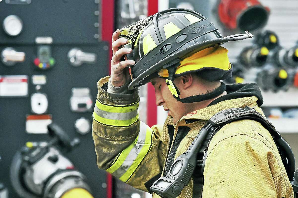 Crews from Milford, Stratford, West Haven, New Haven, Fairfield and Derby battled intense heat and smoke Tuesday at Milford Auto Recycling in Milford.