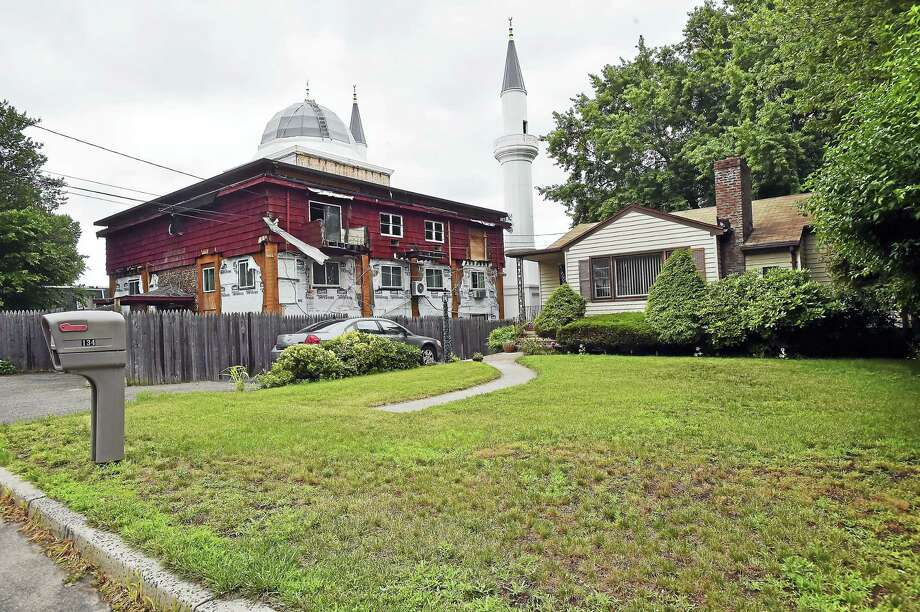 The 81-foot fiberglass minarets flank the 12,000-square-foot mosque's exterior, photographed from Weybosset Street in New Haven. Photo: Catherine Avalone / Hearst Connecticut Media   / Catherine Avalone/New Haven Register