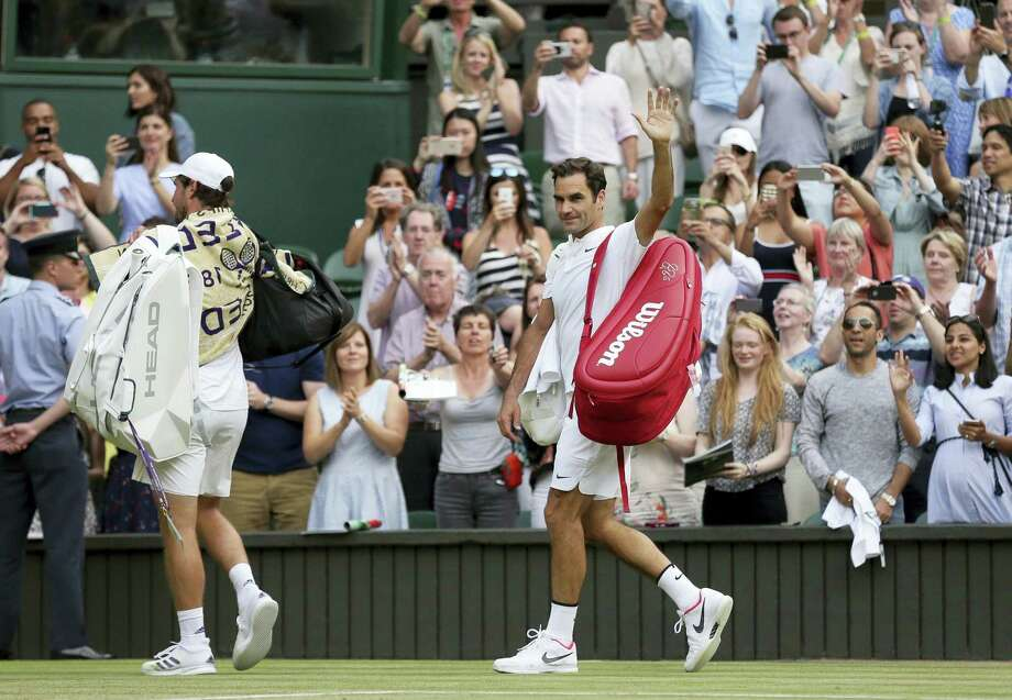 Roger Federer waves as he leaves the court at Wimbledon on Saturday. Photo: Tim Ireland — The Associated Press   / Copyright 2017 The Associated Press. All rights reserved.