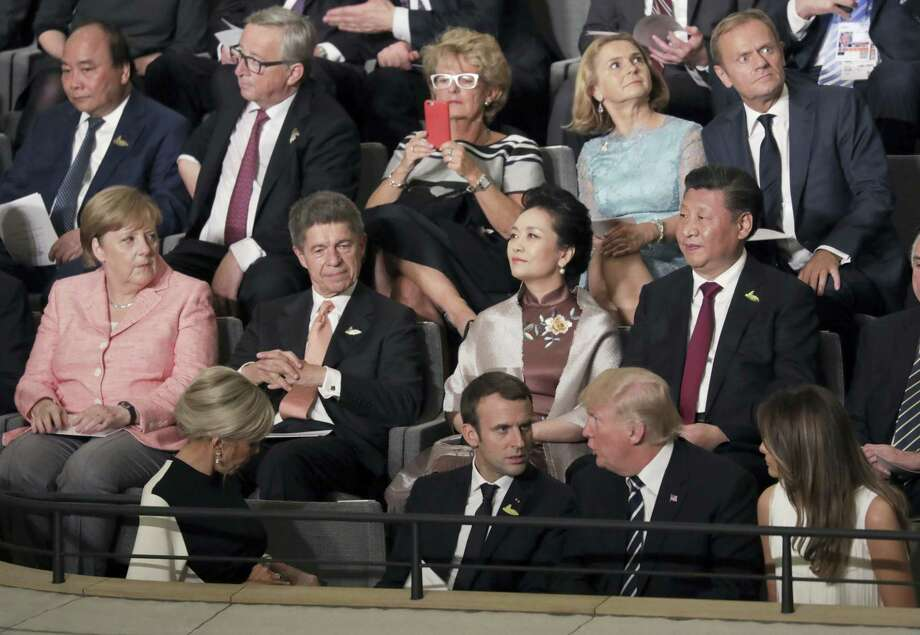 Leaders, including German Chancellor Angela Merkel, left, and their partners attend a concert at the Elbphilharmonie concert hall on the first day of the G-20 summit in Hamburg, northern Germany, Friday, July 7, 2017. Photo: Kay Nietfeld / Pool Photo Via AP   / POOL dpa