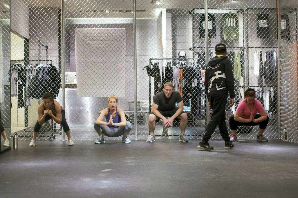 Coss Marte, second from right, conducts a workout class at ConBody Bootcamp Studio at The Wellery on the second floor of the Saks Fifth Avenue flagship store in New York.