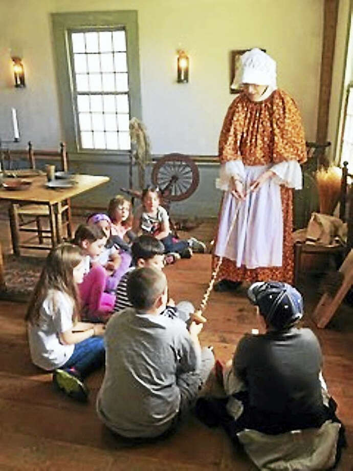The Orange Historical Society staff recently welcomed second-graders to tour the 1740 Nathan Bryan-William Andrew house. Photo: Contributed Photo