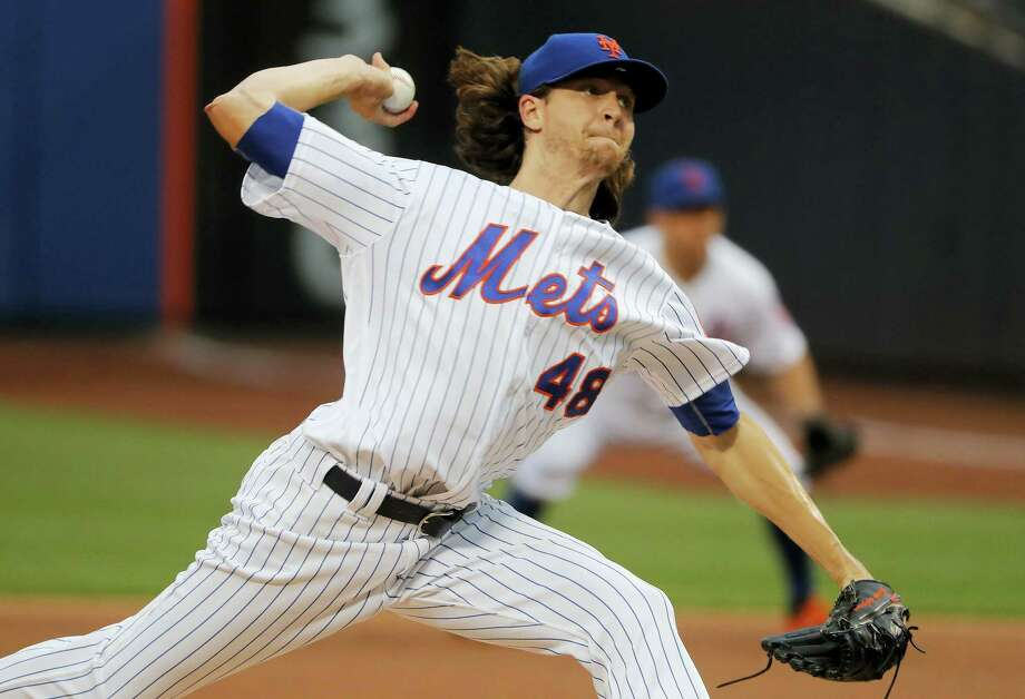 Jacob deGrom delivers against the Phillies on Friday night. Photo: Julie Jacobson — The Associated Press   / Copyright 2017 The Associated Press. All rights reserved.