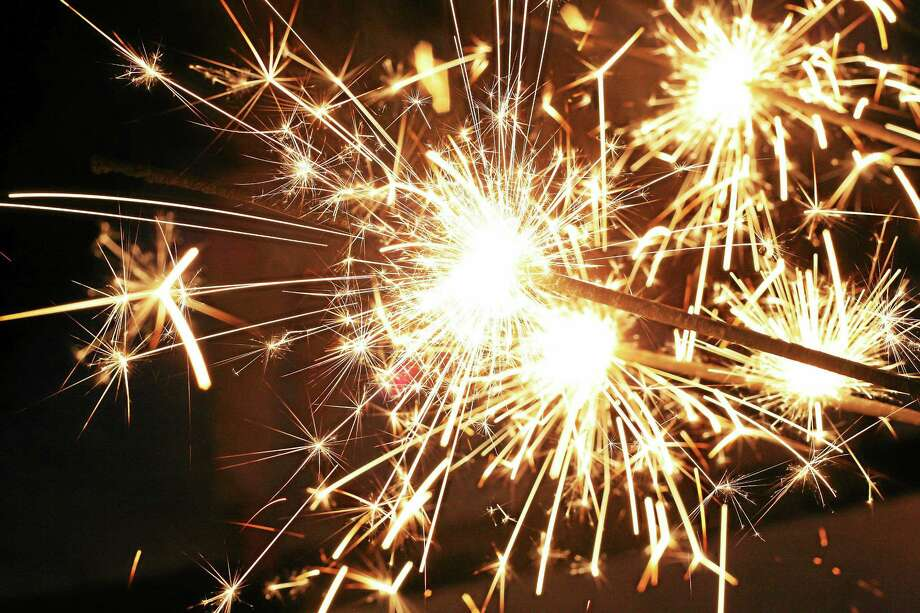 Sparklers are legal in Connecticut — anything that emits a flame are not, state police said. Photo: File Photo