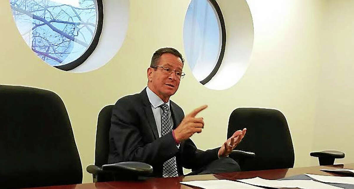 Gov. Dannel P. Malloy makes a point during an editorial board meeting at the Register.
