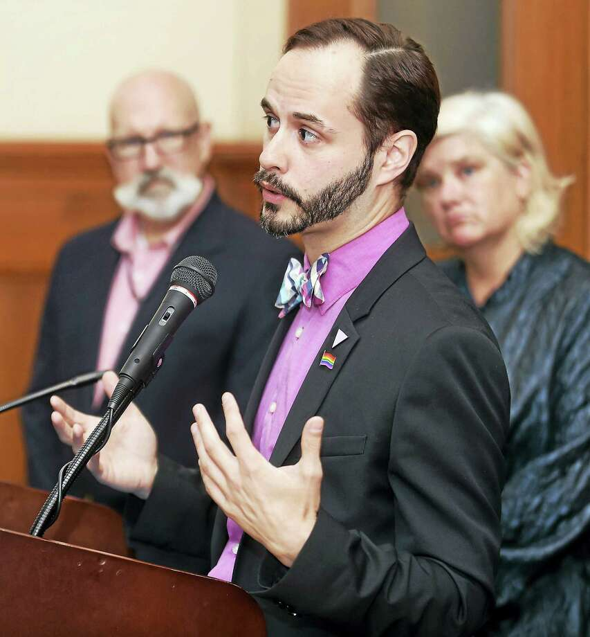 Patrick J. Dunn (center) speaks at City Hall in New Haven after being announced as the first executive director of the New Haven Pride Center on 6/30/2017.  This is the first paid staff position for the center. In the background are John D. Allen (left), co-president and founder of the New Haven Pride Center and Dorian Harding-Morlick, co-president of the New Haven Pride Center.  Arnold Gold / Hearst Connecticut Media Photo: Digital First Media