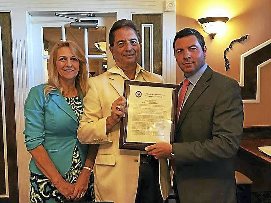 Lou D'Antonio, center, receives a citation in recognition for his years of service from Rep. Rosa DeLauro's office. He is pictured with Adrienn D'Antonio and DeLauro staffer Lou Mangini. Photo: Contributed Photo