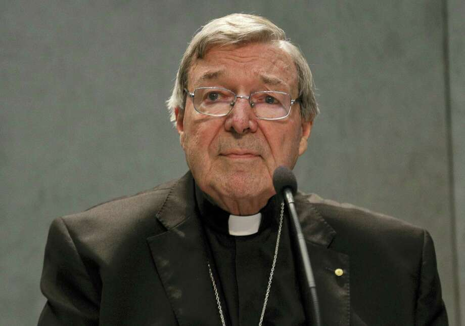 Cardinal George Pell meets the media, at the Vatican on June 29, 2017. The Catholic Archdiocese of Sydney says Vatican Cardinal George Pell will return to Australia to fight sexual assault charges as soon as possible. Photo: AP Photo — Gregorio Borgia   / Copyright 2017 The Associated Press. All rights reserved.
