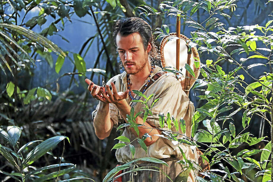 "British naturalist Henry Bates (played by Calum Finlay) examines a rainforest butterfly in a scene from ""Amazon Adventure,"" a new IMAX movie opening this weekend on the six-story screen of The Maritime Aquarium at Norwalk. Photo: Photo Courtesy Of Maritime Aquarium"