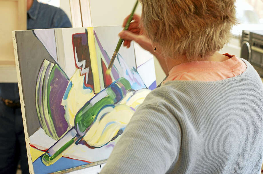 Participants learn brush strokes and techniques at the workshop. Photo: Photo Courtesy Of GAC