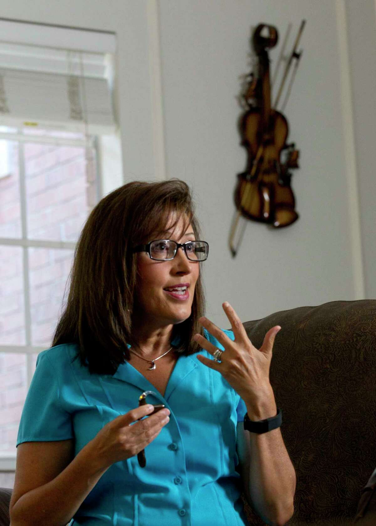 Susan Langlois describes how a cochlear implant, a surgically implanted medical device that sends sounds signals to the brain, changed her life during an interview at her home Wednesday, July 5, 2017, in Spring.