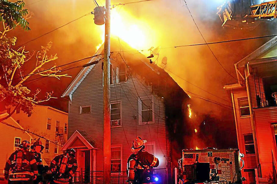 Firefighters respond to a residential fire on Walnut Street early Wednesday morning where fireworks are suspected to be involved. Photo: Courtesy Of Harrison Newman
