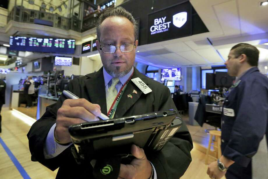 Trader Robert Arciero works on the floor of the New York Stock Exchange, Thursday, June 29, 2017. U.S. stock indexes moved lower in early trading Thursday, giving up some of their gains from the day before. Photo: Richard Drew / AP Photo   / AP