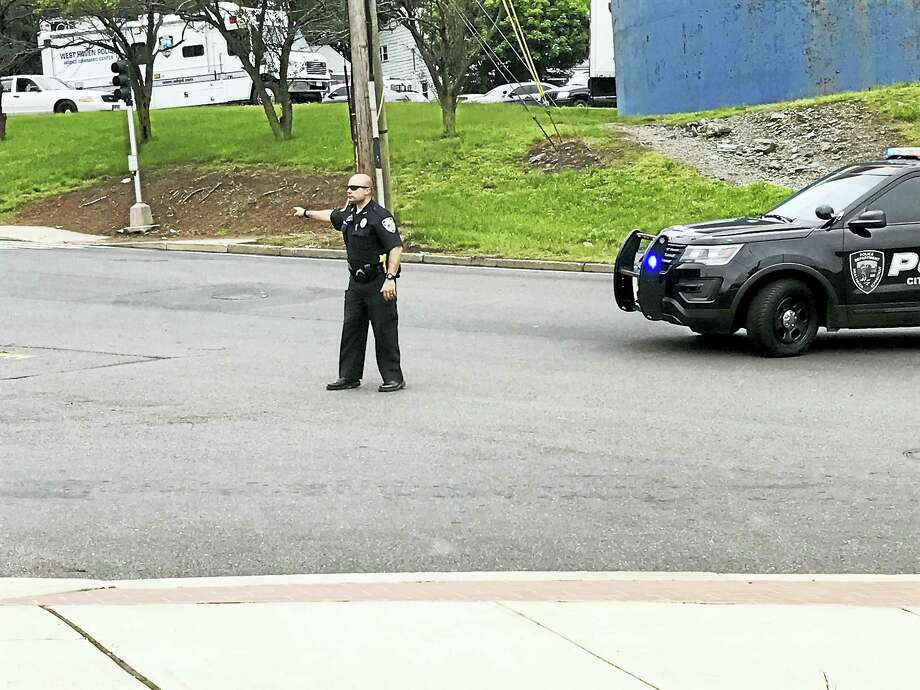 West Haven police respond to a report of two armed suspects inside the Armstrong building. Photo: Jessica Lerner — New Haven Register