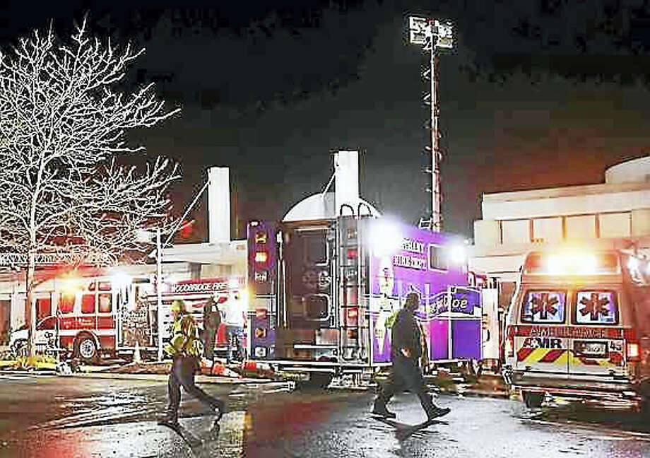 Firefighters and emergency personnel in front of the entrance of the Jewish Community Center during a fire Dec. 5, 2016. Photo: Peter Hvizdak — New Haven Register File Photo