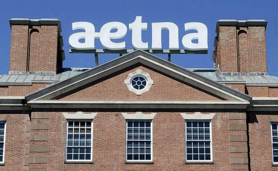 In this Tuesday, Aug. 19, 2014, file photo, a sign for Aetna Inc., sits atop a building at the company headquarters in in Hartford, Conn. Health insurer Aetna Inc. has made a deal to buy competitor Humana Inc. in a $37 billion deal the companies say would create the second-largest managed care company, it was announced Friday, July 3, 2014. Photo: Jessica Hill — AP Photo, File   / FR125654 AP
