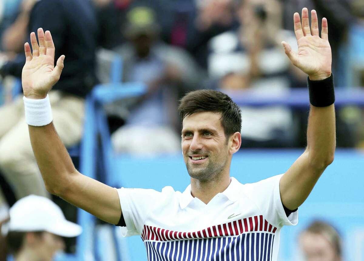 Serbia's Novak Djokovic celebrates his victory over Canada's Vasek Pospisil during their quarterfinal match on day five of the AEGON International tennis tournament at Devonshire Park, Eastbourne, England, Wednesday June 28, 2017. (Gareth Fuller/PA via AP)