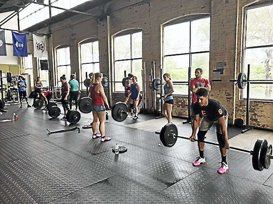 The PK workout consisted of five rounds of 10 repetitions of 225-pound back squats, 10 repetitions of 275-pound dead lifts and a 400-meter sprint, followed by a two-minute rest. Photo: Photo Courtesy Of CrossFit New Haven