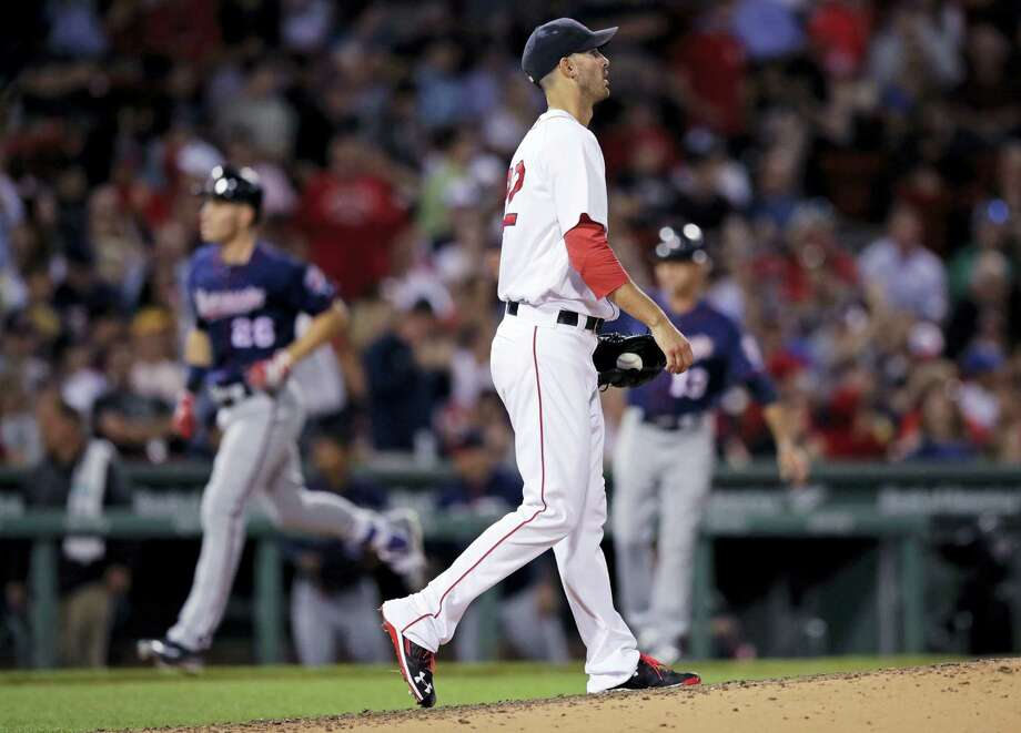 Red Sox starting pitcher Rick Porcello walks back to the mound as the Twins' Max Kepler rounds the bases on his two-run home run during the sixth inning Wednesday. Photo: Charles Krupa — The Associated Press   / Copyright 2017 The Associated Press. All rights reserved.