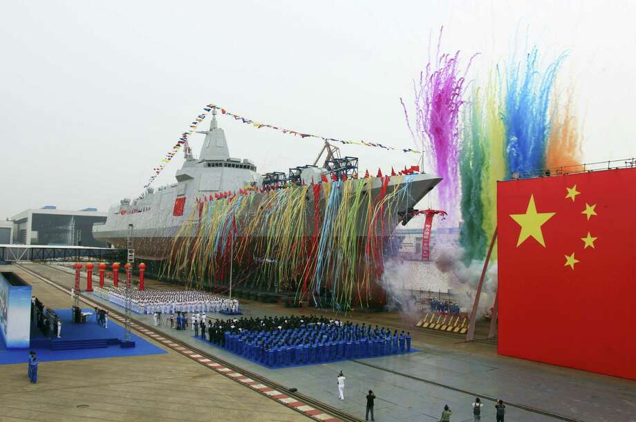 In this photo released by Xinhua News Agency, fireworks explode next to China's new domestically-built 10,000-ton Type 055 destroyer during a launching ceremony at Jiangnan Shipyard in Shanghai, China on June 28, 2017. China's increasingly powerful navy launched its most advanced domestically produced destroyer on Wednesday, at a time of rising competition with other naval powers such as the United States, Japan and India. Photo: Wang Donghai — Xinhua Via AP   / Xinhua