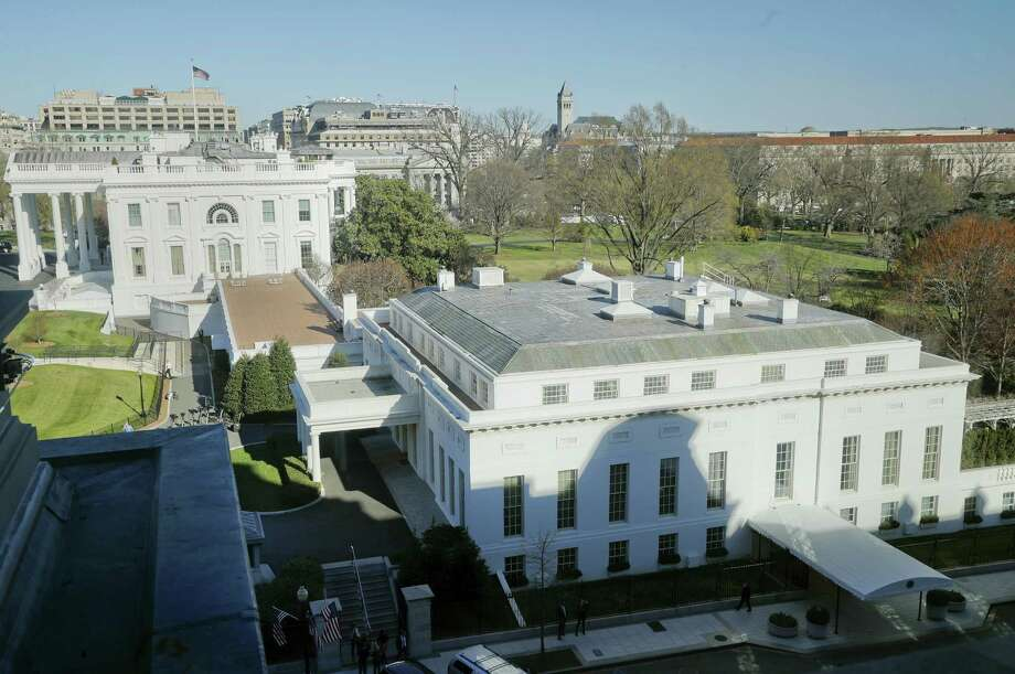 In this photo taken March 29, 2017, the main residence of the White House in Washington and the West Wing, right, as seen Wednesday from the Eisenhower Executive Office Building on the White House complex in Washington. A top White House communications staffer has resigned as President Donald Trump considers overhauling his White House staff over frustrations that his team is struggling to contain the burgeoning crisis involving alleged Russian meddling in the 2016 election. Photo: AP Photo — Pablo Martinez Monsivais, File   / Copyright 2017 The Associated Press. All rights reserved.