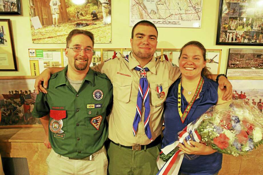 Eagle Scout James Chopak, center, with mom Michele and stepfather Jim Calkins. Photo: Courtesy Of Randy Ritter