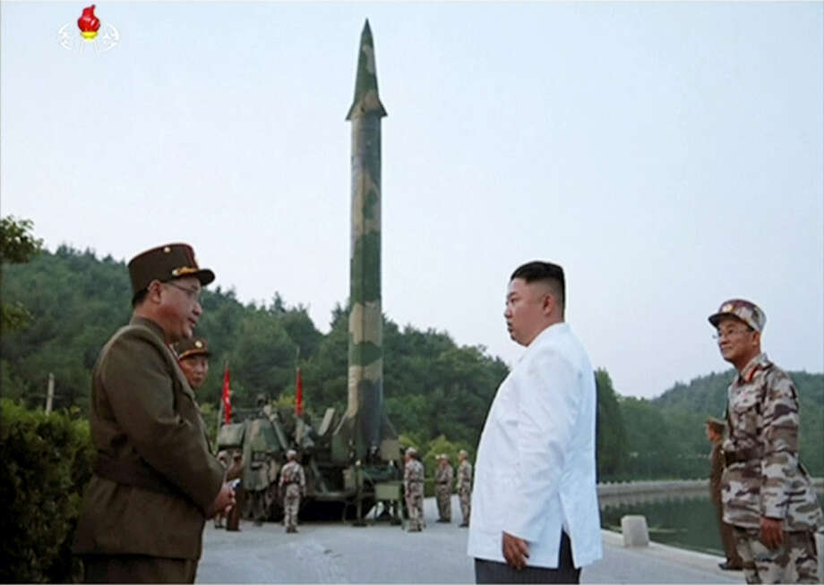 This image made from video of an undated still image broadcasted in a news bulletin on Tuesday, May 30, 2017, by North Korea's KRT shows North Korean leader Kim Jong Un and a missile launcher in North Korea. North Korean state television (KRT) aired on Tuesday video of Kim apparently giving field guidance at the test fire of a Scud-type ballistic missile, which reportedly took place the previous day. Independent journalists were not given access to cover the event depicted in this photo. Photo: KRT Via AP Video   / KRT via AP Video