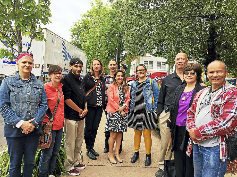 Some of the supporters who attended a visit to the Immigrations and Cutoms Enforcement office in Hartord where Wilmer Galo-Andino had to report for an update on his deportation case. His attorney, Yazmin Rodriguez, is at center. Photo: MARY E. O'LEARY — NEW HAVEN REGISTER