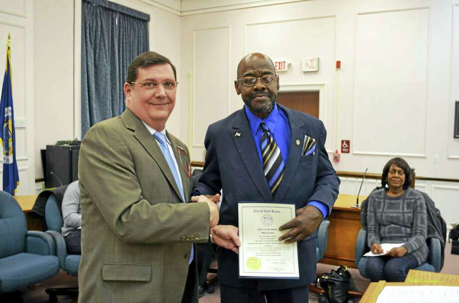 "West Haven on Saturday will name a ""pocket park"" on Tile Street after late City Councilman Brent Watt, who is seen here being honored as West Haven's African-American Citizen of the Year on Feb. 29, 2016, four months before he died. Watt, who had served as 5th District councilman since 2011, died June 25, 2016. He was 54. Photo: Michael P. Walsh/City Of West Haven"
