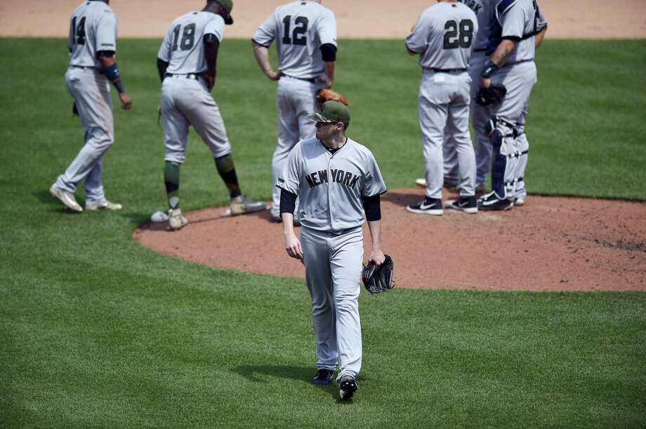 New York Yankees starting pitcher Jordan Montgomery, center, walks to the dugout after he was pulled during the fifth inning against the Baltimore Orioles Monday. The Yankees lost 3-2. Photo: NICK WASS - THE ASSOCIATED PRESS   / FR67404 AP
