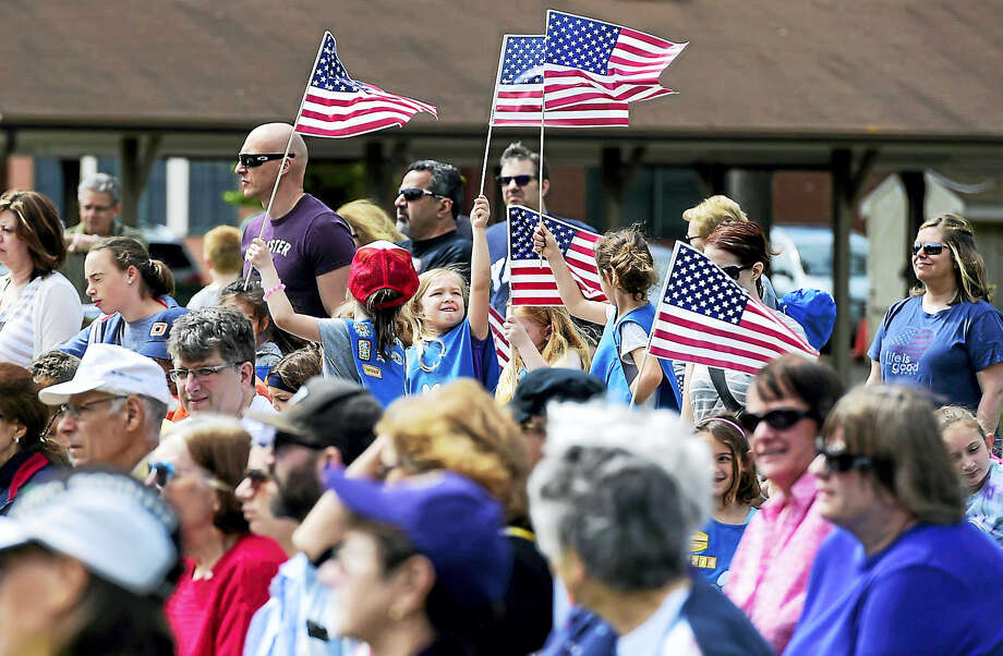 In Orange Sunday, May 28, 2017, a crowd listens to speakers during Memorial Day ceremonies at the High Plains Community Center. Photo: Peter Hvizdak — New Haven Register