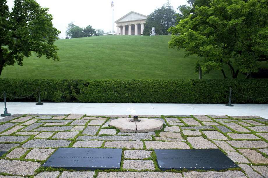 The graves of President John F. Kennedy, left, and his wife Jacqueline Kennedy Onassis at Arlington National Cemetery in Arlington, Va., Monday, May 29, 2017. Kennedy was born May 29, 1917. Photo: AP Photo/Cliff Owen    / FR170079 AP