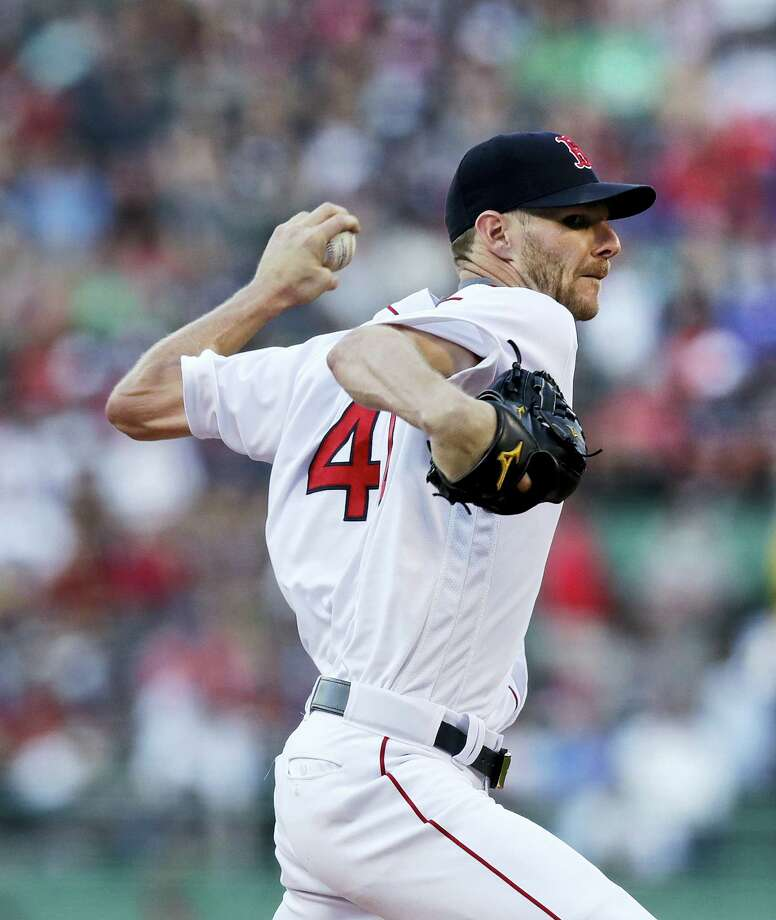 Boston Red Sox starting pitcher Chris Sale delivers during the first inning of a baseball game against the Minnesota Twins at Fenway Park in Boston, Monday. Photo: Charles Krupa - The Associated Press   / Copyright 2017 The Associated Press. All rights reserved.