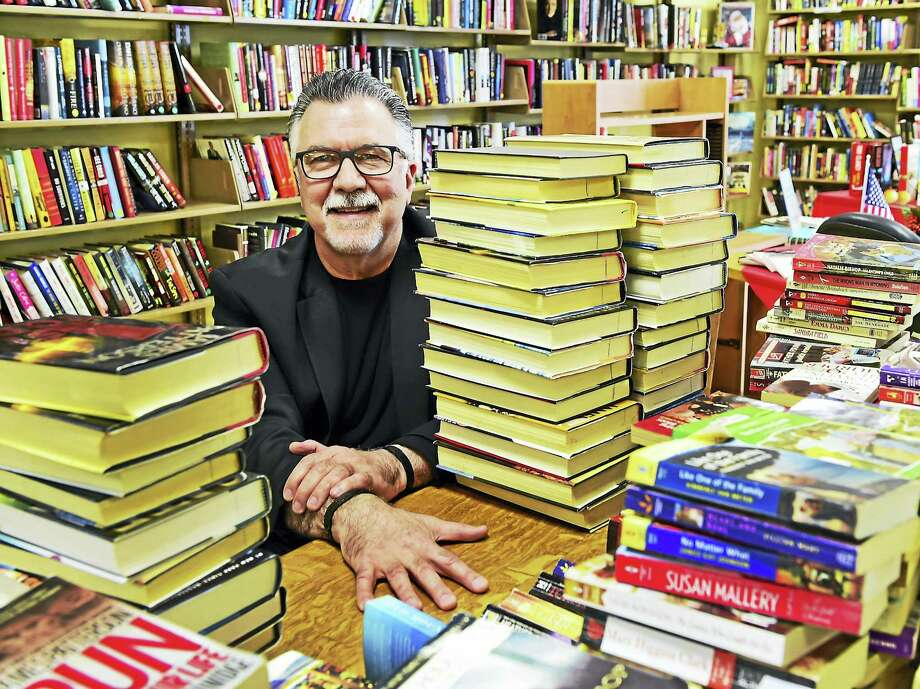 Mark O'Brien, executive director of Literacy Volunteers Valley Shore CT in a Literacy Volunteers workspace at the Westbrook Library surrounded by books, that will be sold as a fund-raiser for the organization. Photo: Peter Hvizdak — New Haven Register   / ©2017 Peter Hvizdak