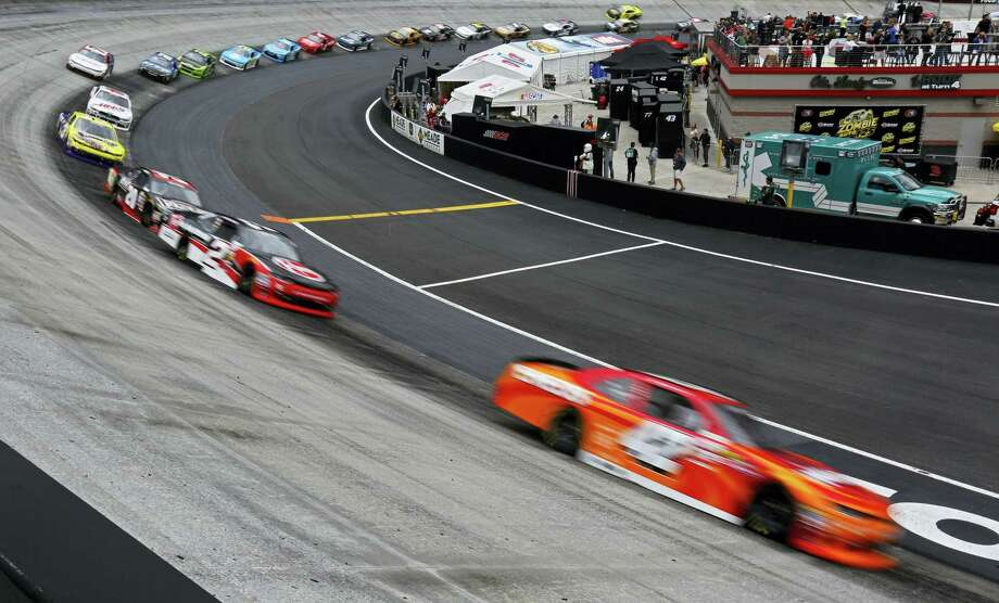 Driver Kyle Larson, right, leads the field through turn four during the NASCAR Xfinity Series auto race on Saturday in Bristol, Tenn. Photo: Wade Payne — The Associated Press   / FR23601 AP