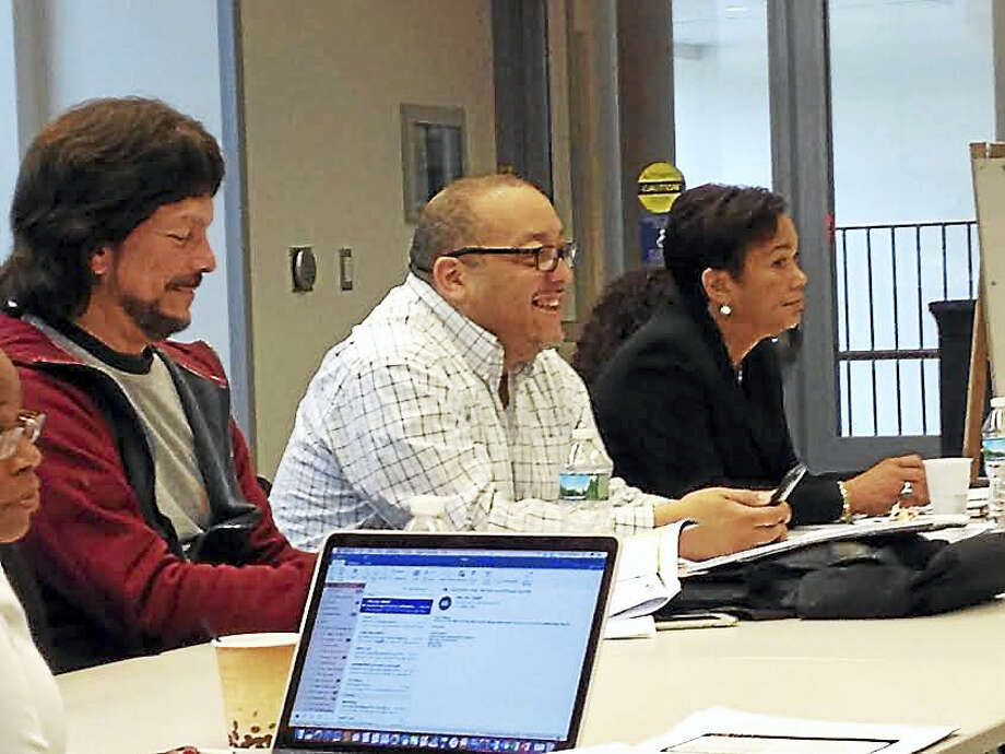 From left, Carlos Torre, Darnell Goldson and Mayor Toni Harp participate in a May 13 Board of Education retreat at East Rock Community Magnet School. Photo: Brian Zahn - New Haven Register